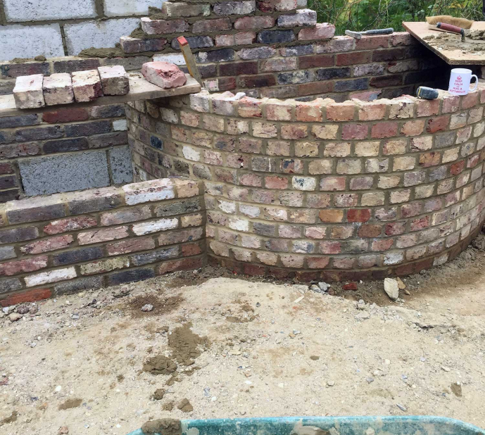Reclaimed brick water feature and garden wall