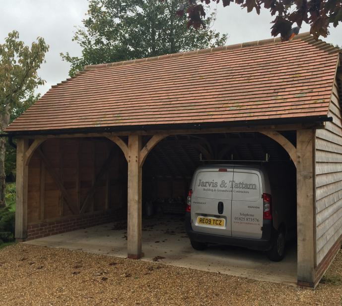 Carport with oak frame and tiled roofing.