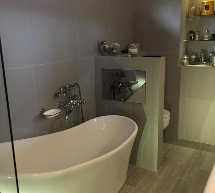 Recent wetroom/ensuite bathroom project. Fitted with waterproof Tv opposite bath, 2x showers in wetroom area, motion sensor toilet flush and perfume display.